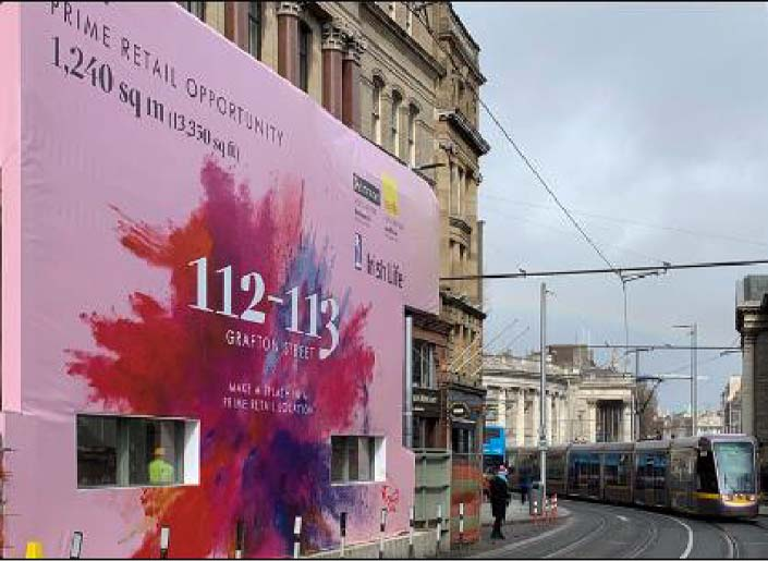 A tailormade banner wrap advertises to tram commuters in Dublin city centre