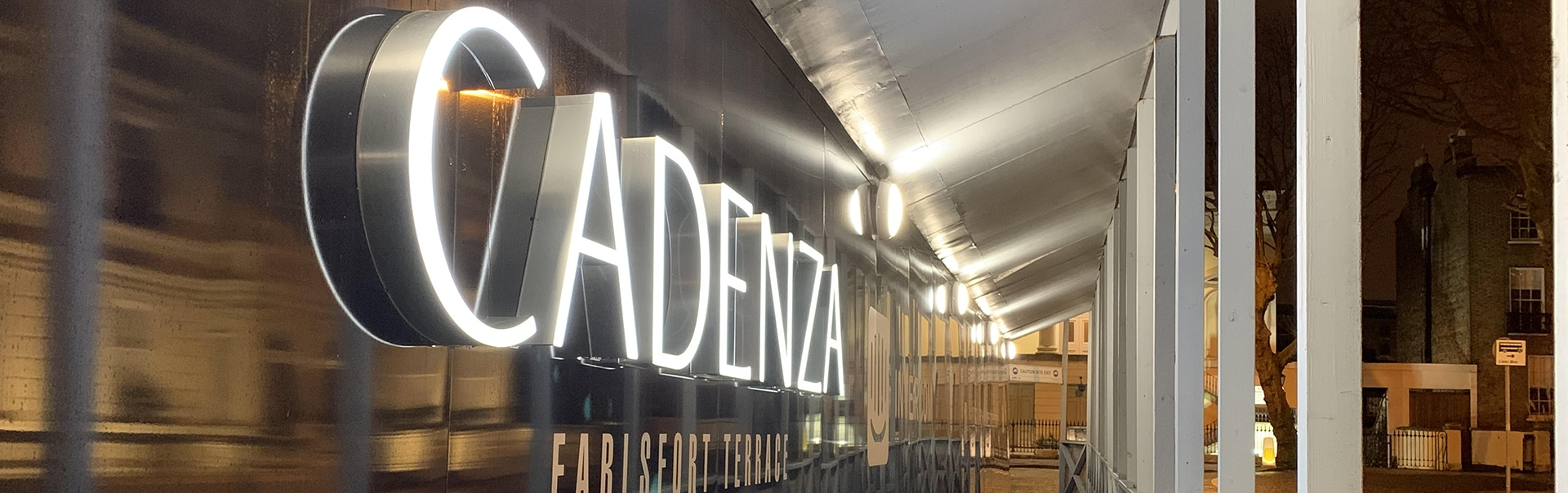 Illuminated letters attract attention to a construction site hoarding