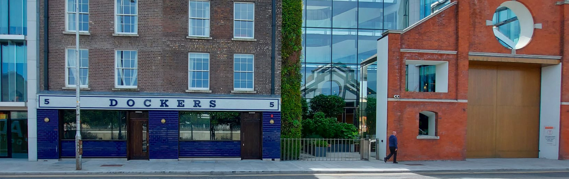 Colour matched lettering complements the mosaic tile frontage on the new look Dockers pub at Windmill Lane