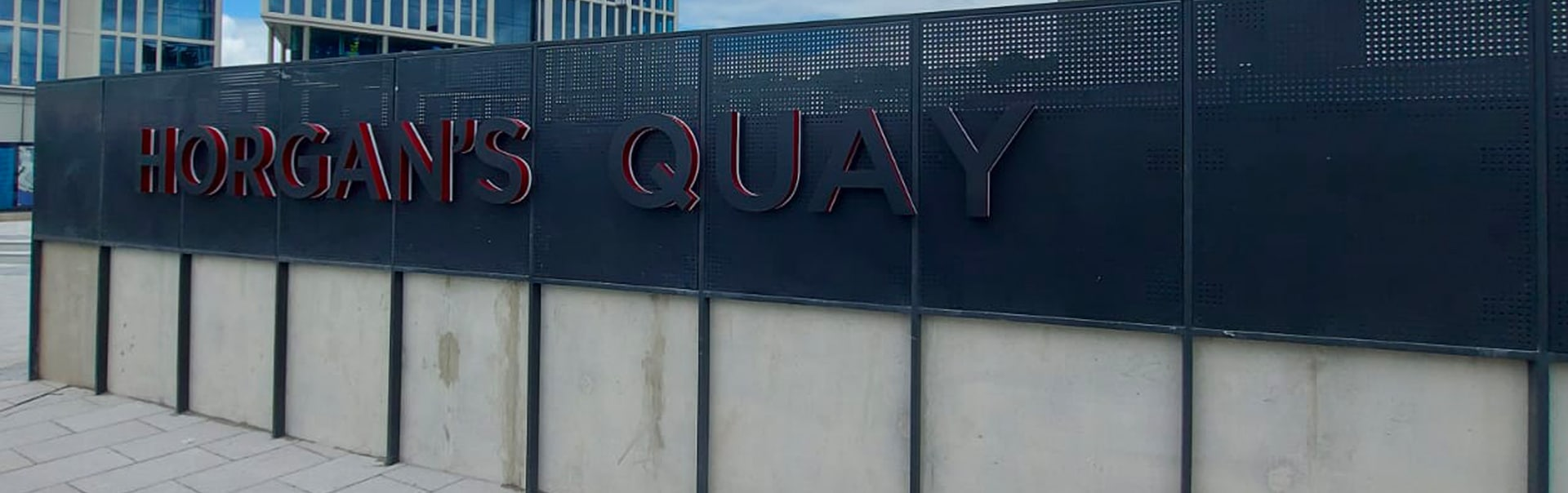 An illuminated logo announces the new city quarter at Horgan's Quay