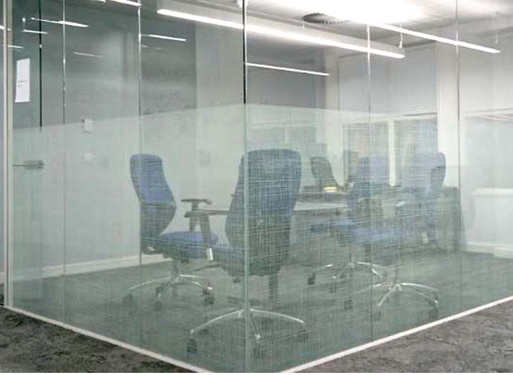 Frosted vinyl privacy screening for a glass walled meeting room