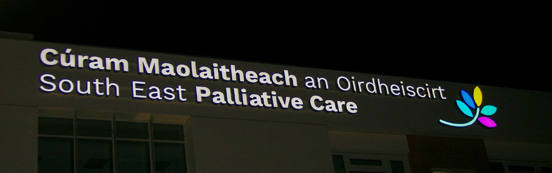 Facelit sign at night, South East Palliative Care, Waterford