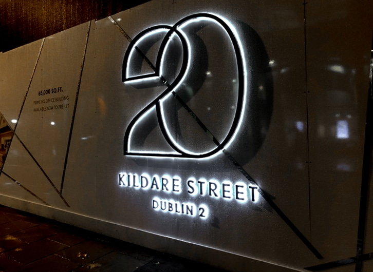 Fine font logo with side lighting. Placemaking for the new Kennedy Wilson development at 20 Kildare Street, Dublin