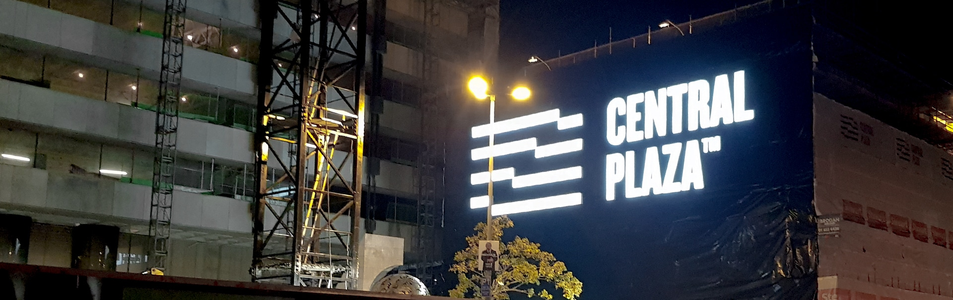 A huge facelit sign brands a new city centre destination