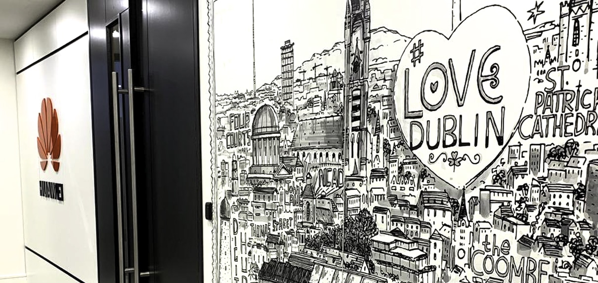 A Steve Simpson artwork is screenprinted directly onto the wall panels in this Huawei lift lobby