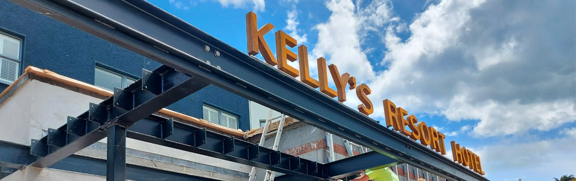 Installing a corten steel canopy sign at Kelly's Resort Hotel Wexford