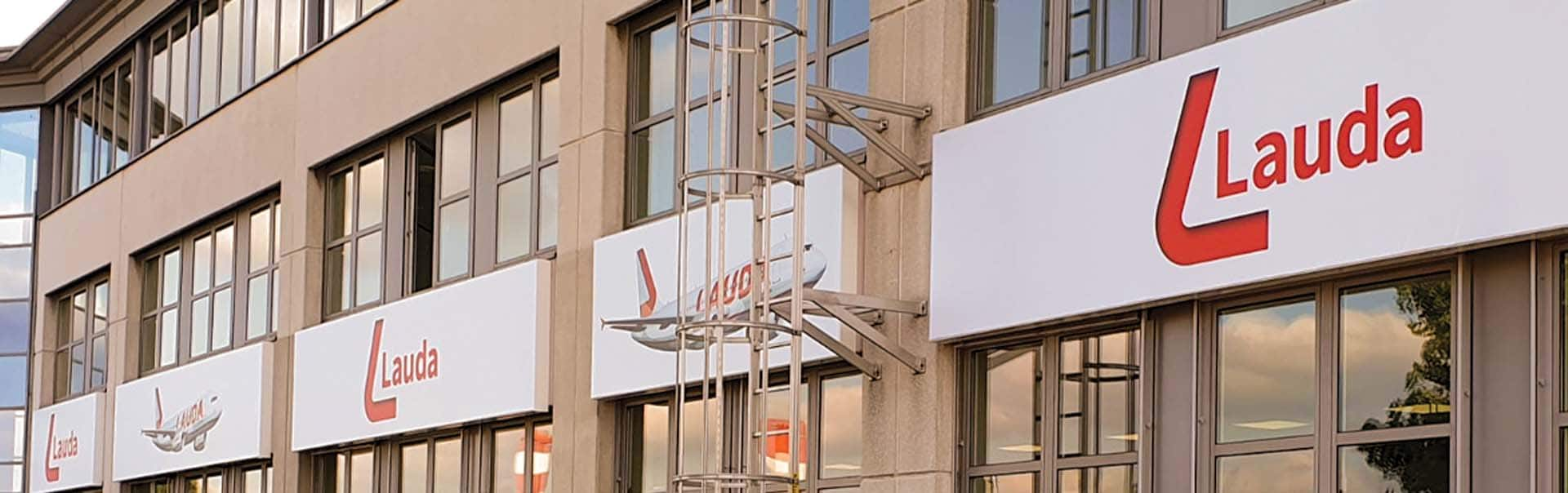 Fret-cut fascia signage rebrand at Laudamotion HQ, Vienna