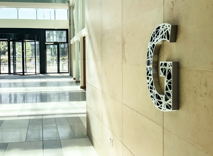 Bespoke stainless steel floor numbers echo architectural detailing at One South County, Dublin