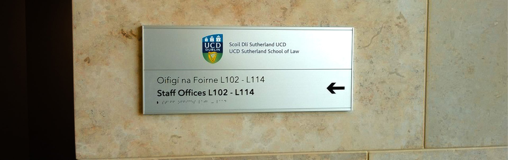 A braille wayfinding plaque points the way to the staff offices at UCD's School of Law
