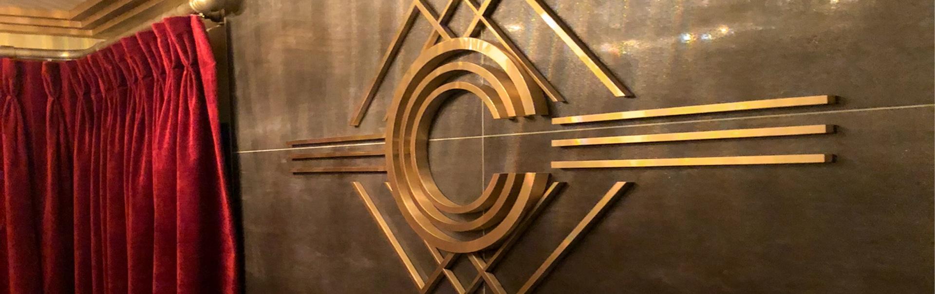 Brass wall logo at Dublin's Carlton Casino Club