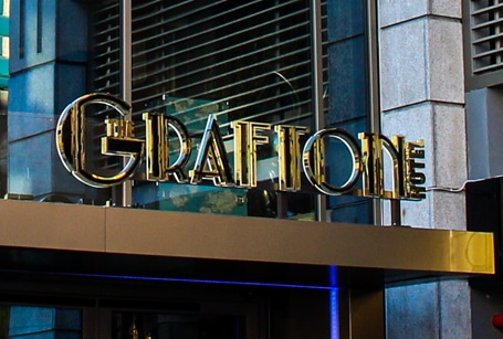 Guests at Dublin's Grafton Hotel are welcomed by a polished titanium gold sign with black inlays