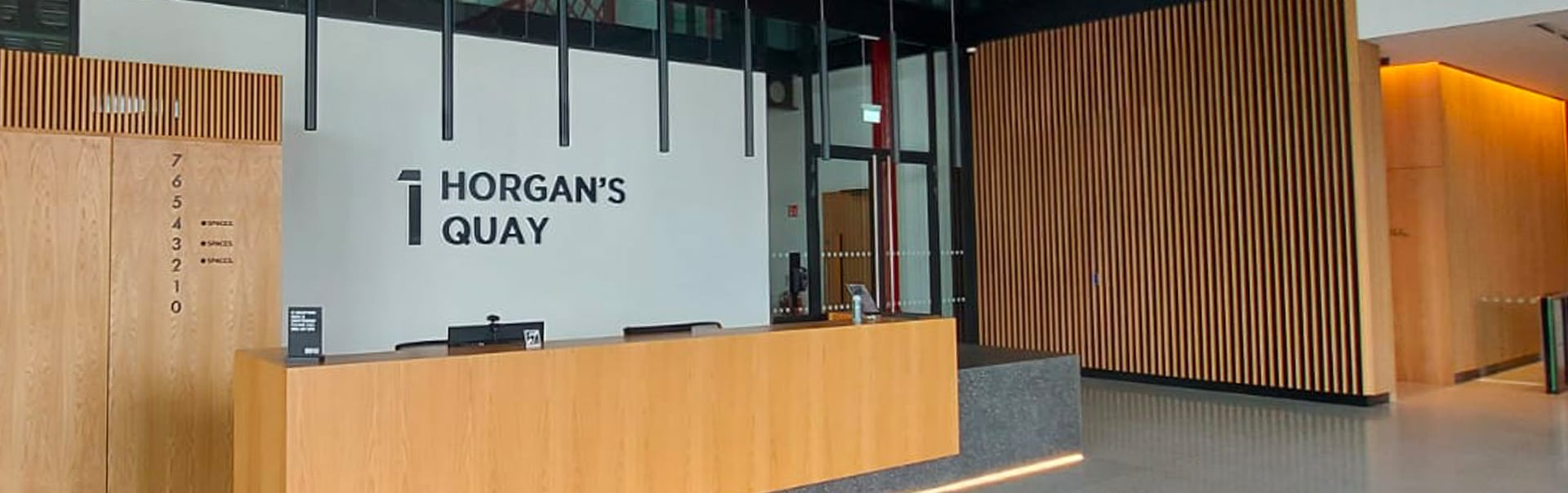 Horgan's Quay directory and reception sign in painted stainless steel lettering.