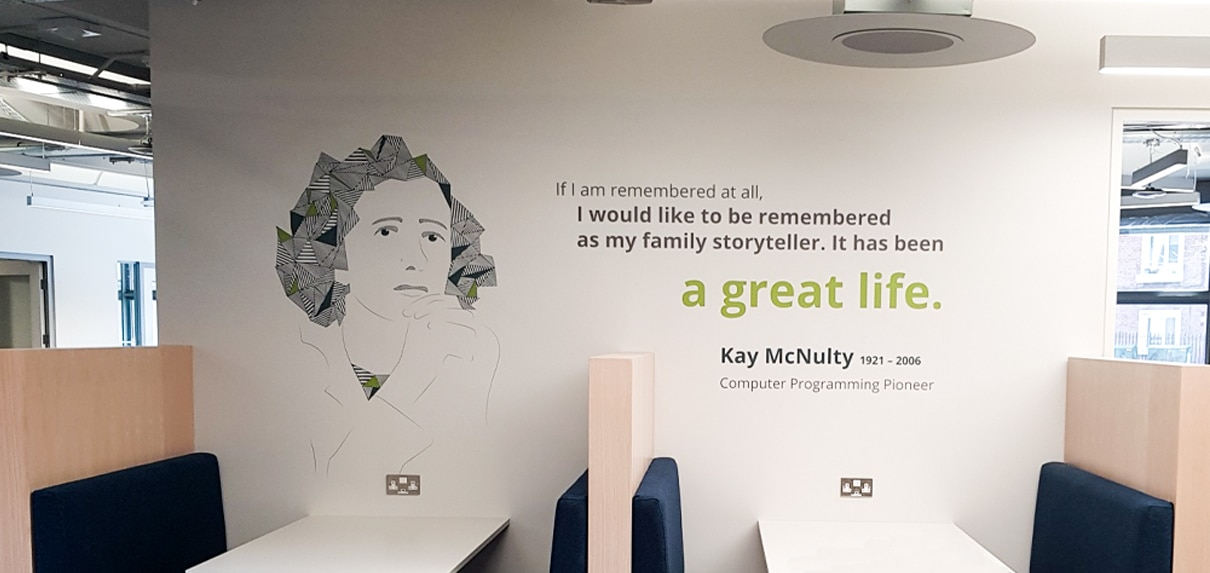 Wall mural supergraphics at New Relic EMEA HQ feature illustrations of famous mathematicians