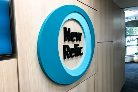 A three-dimensional painted acrylic logo in the breakout area of New Relic's EMEA HQ in Dublin