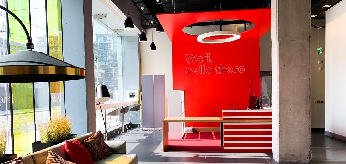 A welcome message in LED neon greets visitors to Virgin Media headquarters