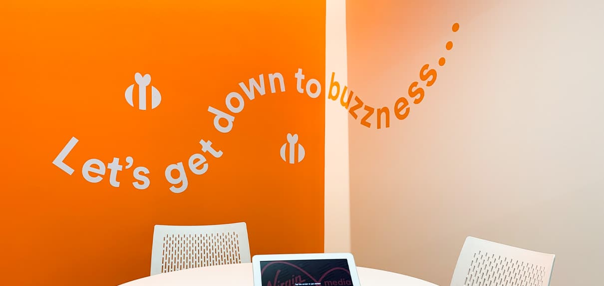 A fun wall vinyl brightens the mood in this meeting room