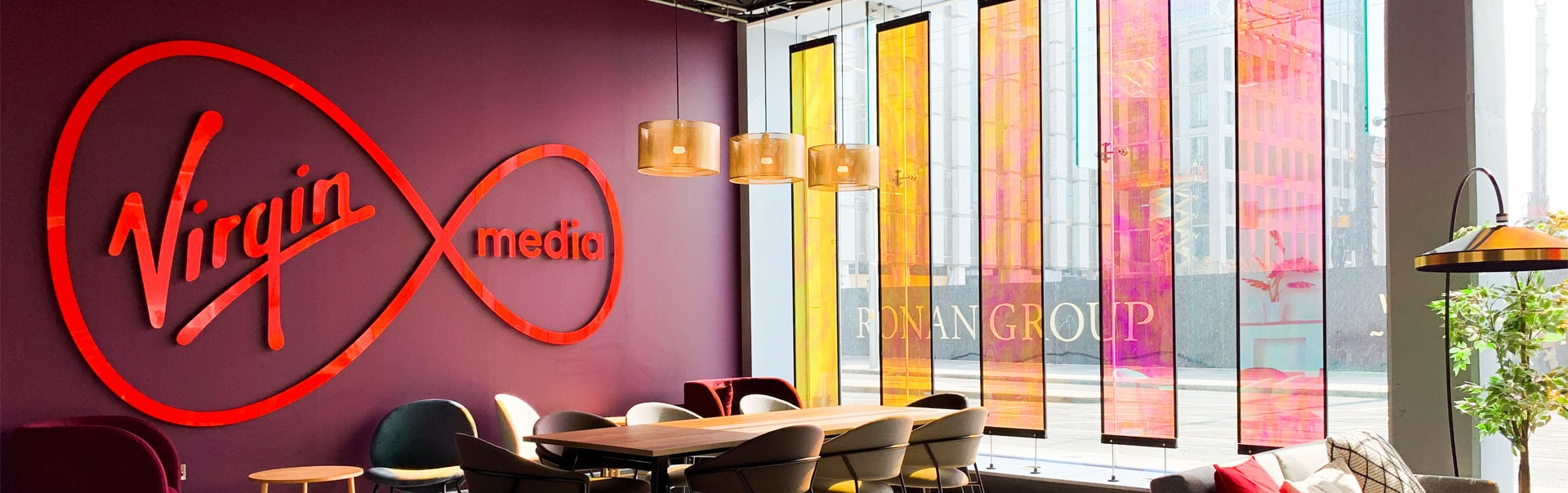 Dichroic privacy screens play tricks with the light and keep this lounge area interesting