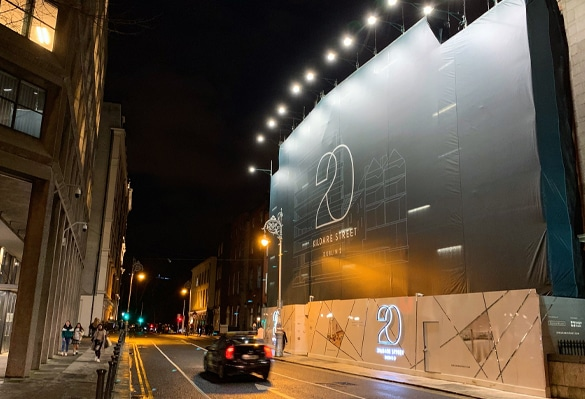 A bank of LED floodlights gives 20 Kildare Street a prominent presence at night