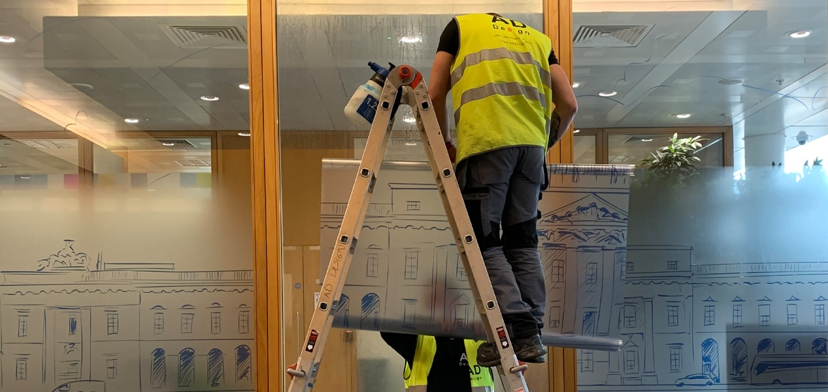 Fitters screen a corporate meeting room with glass manifestations