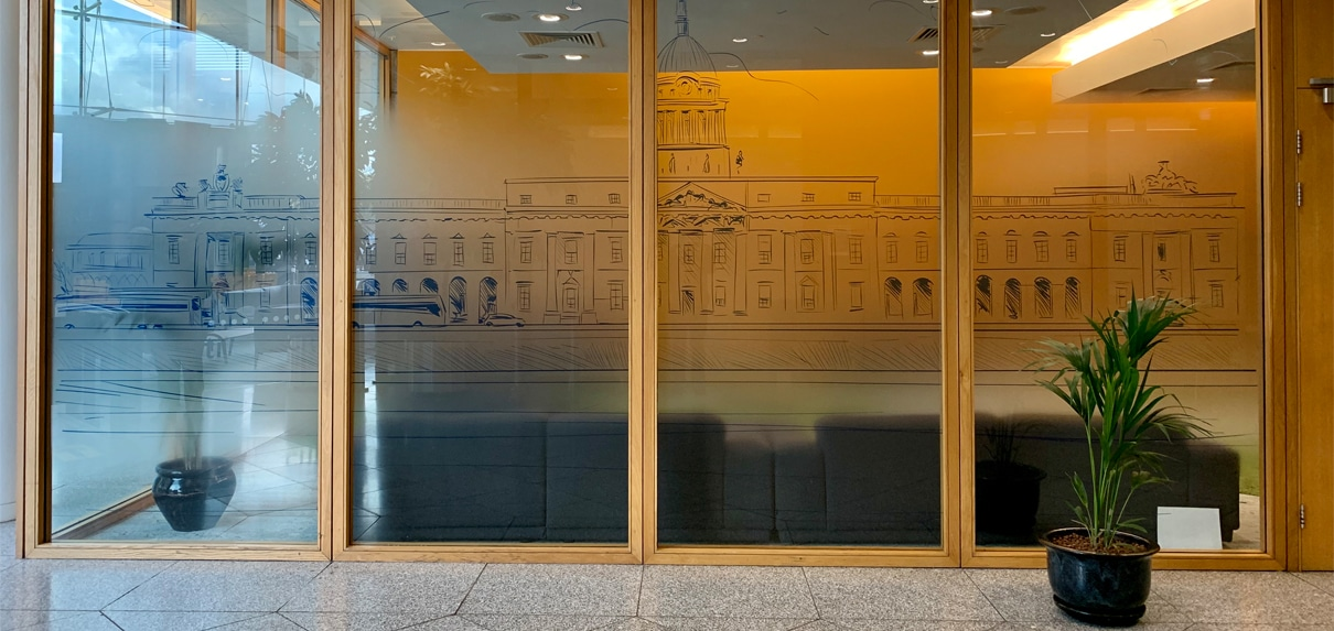 An optically clear glass manifestation screens a corporate lounge