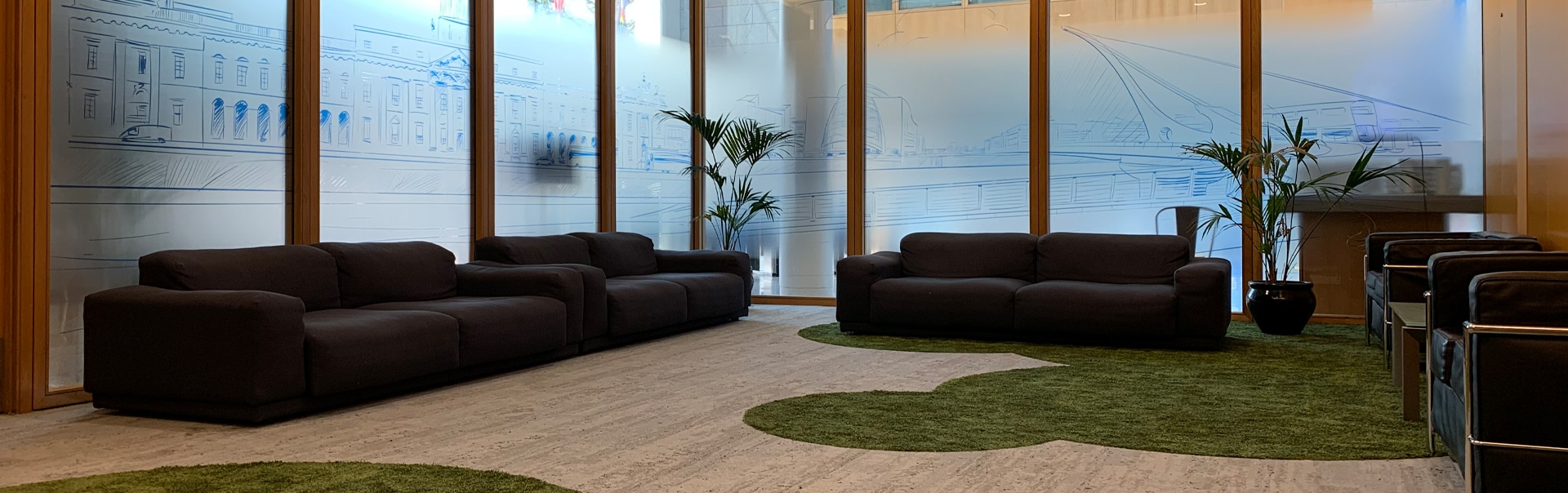This corporate lounge is kept private with optically clear window manifestations